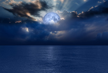 "Night sky with moon in the clouds ""Elements of this image furnished by NASA"