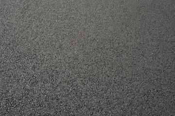 Hintergrund frisch verdichteter Asphalt als Schrägaufnahme - Background of freshly compacted asphalt as an inclined view