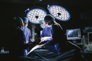 Medical team performing surgery in hospital