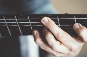 Elderly man playing carbon fiber guitar