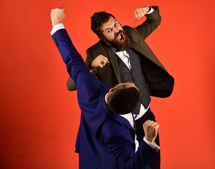 Men with beards fight on red background.