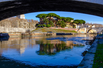 Travel photography - walking along the banks of the Tiber (Rome, Italy, Europe).