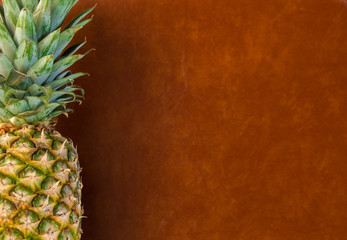 Appetizing pineapple on a vintage brown background with plenty of space to add text or other elements.