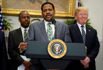 U.S. President Donald Trump signs a proclamation to honor Martin Luther King Jr. day at the White House in Washington