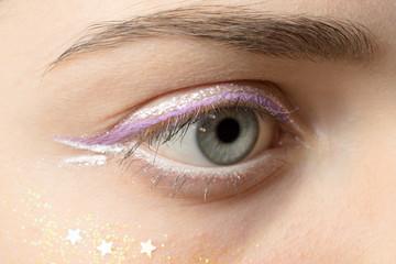 close up woman eye with bright makeup macro shot