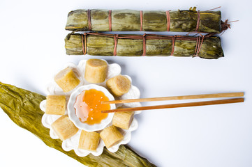 Chopsticks taking slice of zongzi for Dragon boat festival from table