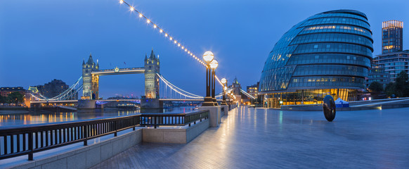 Garden Poster London LONDON, GREAT BRITAIN - SEPTEMBER 19, 2017 - The panorama of the Tower bridge, promenade with the the modern Town Hall building at dusk.