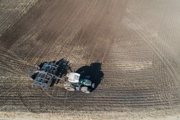 Aerial of tractor plowing the field