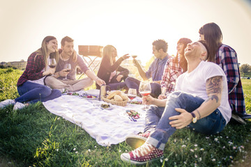 Happy friends having picnic in a park Wall mural