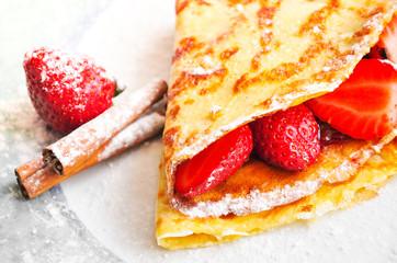 Strawberry pancake sprinkled with fine sugar