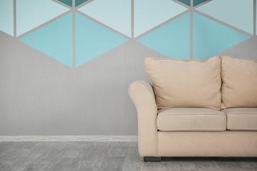 Cozy sofa near colorful wall