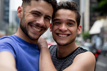 Gay Couple taking a selfie in Paulista Avenue, Sao Paulo, Brazil
