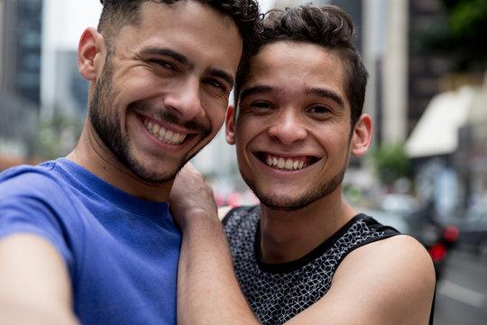 Gay Couple taking a selfie in Paulista Avenue, Sao Paulo, Brazil