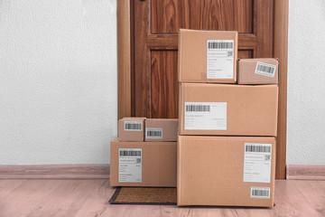 Parcel boxes on floor near door