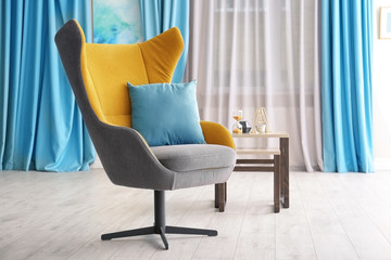 Comfortable armchair in living room interior