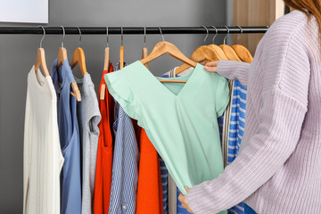 Woman choosing outfit in dressing room