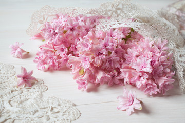 Pink hyacinths and lace on the table
