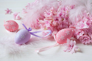 Easter background with pink hyacinths, decorative eggs
