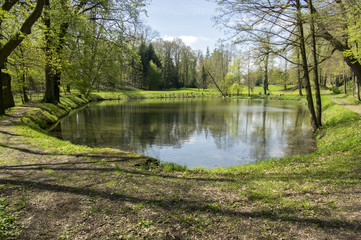 Gardens with pond during spring season, romantic scene, water reflections