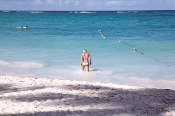 Young woman on the beach of Punta Cana, a holiday resort. Dominican Republic.