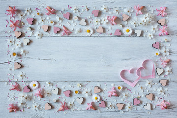 Wooden background with spring flowers, hyacinths, daisies and hearts
