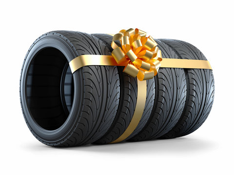Car tires wrapped in a gift ribbon with a bow 3D