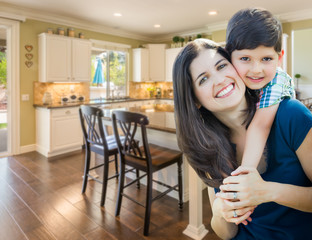 Young Mother and Son Inside Beautiful Custom Kitchen.