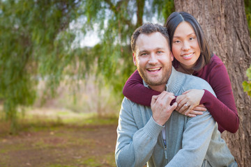 Mixed Race Caucasian and Chinese Couple Portrait Outdoors.