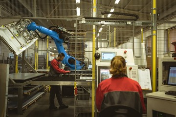 Female worker operating machine
