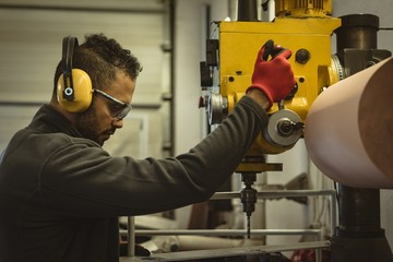 Male worker operating a machine