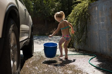 Girl holding blue bucket