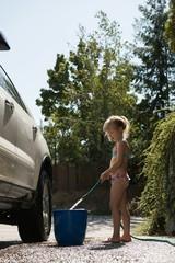 Girl filling water in bucket