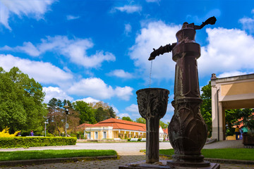 Water fountain and historical building on spa island in Piestany (SLOVAKIA)
