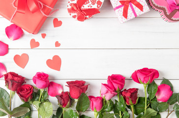red and pink rose  with gift box on wood