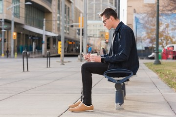 Man using mobile phone while having coffee