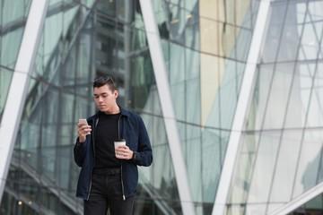 Man using mobile phone while having coffee