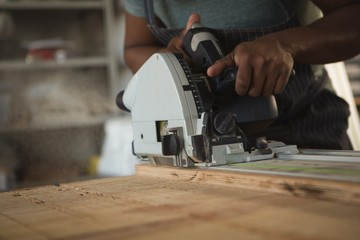 Mid section of carpenter leveling wood