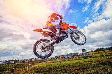 Dirtbike. Dirt bike extreme jump on motocross sunset