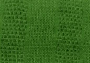 Green kitchen towel texture.