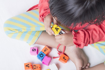 Kid's hands plug and play the alphabets toys