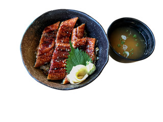 "Japanese food ""Unagi don (Unadon)"", steamed rice topped with fillet of freshwater eel grilled served with miso soup isolated on white background, clipping path included."