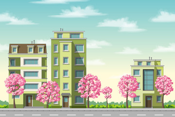 Some houses with flowering trees