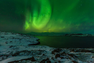 Northern Lights on the shore of the Arctic Ocean.