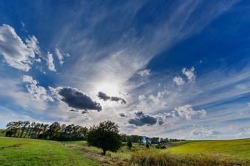 Amazing cloudscape with beautiful trees, Armenia