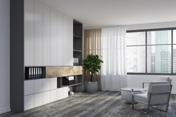 White living room corner, white armchairs