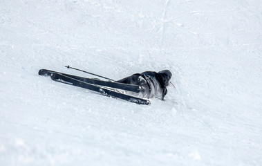 The fall of the skier in the snow
