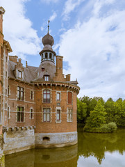 Tower and moat in Ooidonk castle