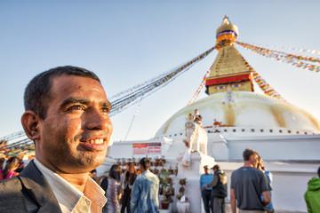Nepali in front of Boudha Stupa, Kathmandu; Nepal