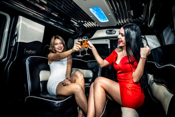Beautiful girls making party in the limousine