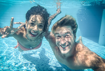 happy couple underwater